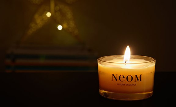 Neom travel size candle (enjoying it in my living room :)